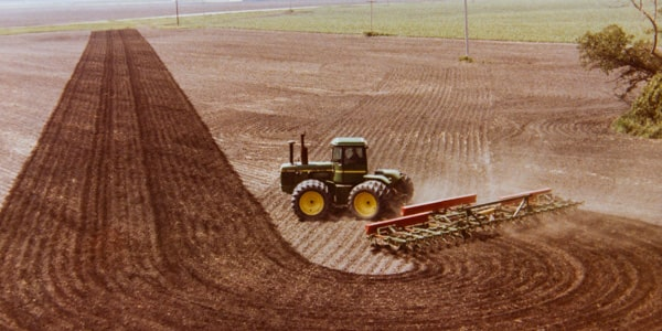 History of Campbell Farms - tilling a field
